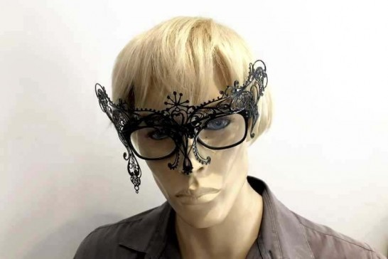 masquerade mask that attaches to glasses frames shown on man