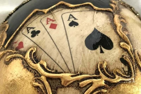 Four aces on a masquerade mask