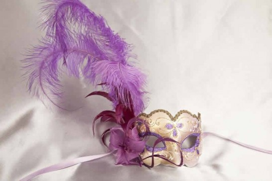Purple and gold feathered mask