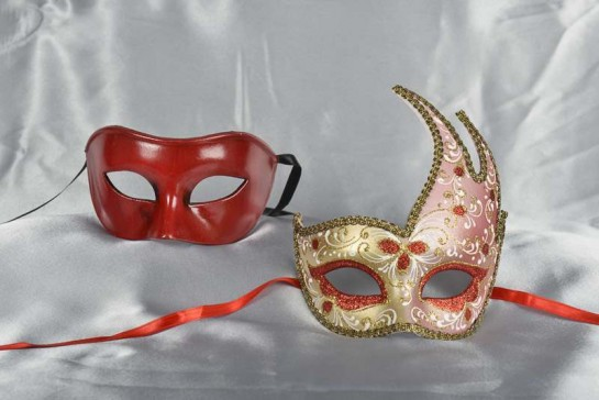 Couples masquerade masks in red and gold