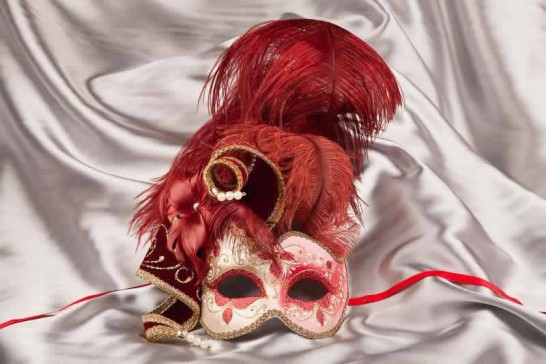 Red and gold trim Venetian jolly mask with feathers and jester bells