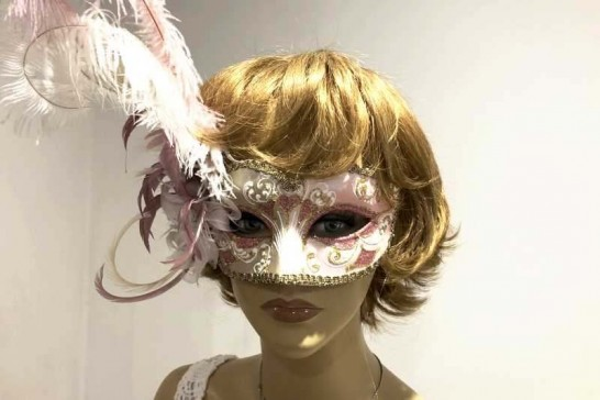 Ladies feathered ball mask on female face