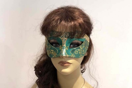 Carnival masquerade mask in gold on female face