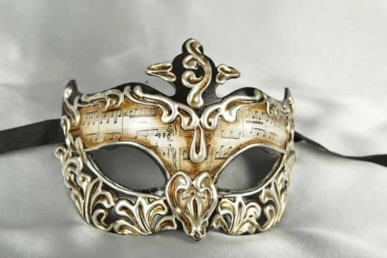 black paper mache mask with musical notes