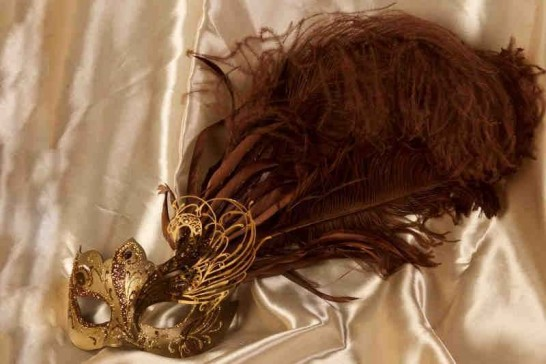 Paper mache Venetian mask with filigree detail and luxury tall feathers in gold and bronze