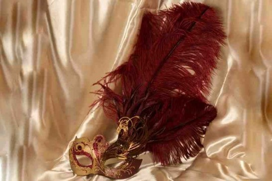 Paper mache Venetian mask with filigree detail and luxury tall feathers in gold and red