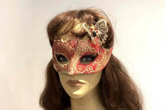 gold butterfly ball mask on female face
