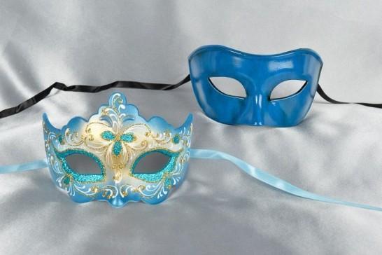 two Venetian masks in turquoise gold trim for a couple