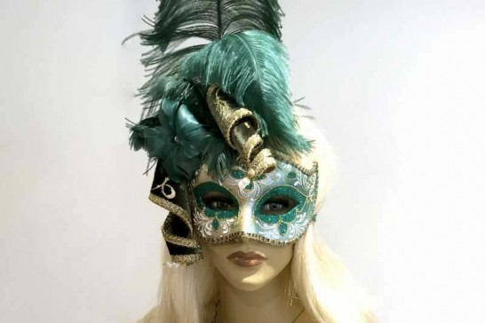 Gold trim Venetian jolly mask with feathers and jester bells in green on female face