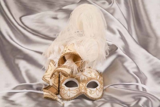 White and gold trim Venetian jolly mask with feathers and jester bells