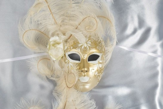 White and Gold full face wall mask with feather surround close up