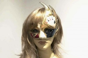Poker decorated Cigno Swan animal masquerade mask on female face