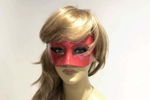 Colombina masquerade mask in red shown on female face