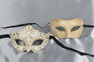 Pair of cream and gold masquerade masks