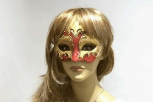 Carnival masquerade mask with gold leaf on female face