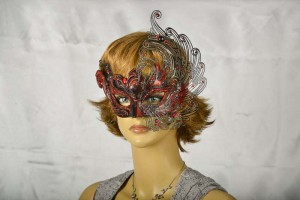 red and black masquerade mask on female face