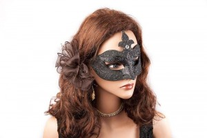 black masquerade mask for a woman on female face