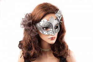 silver butterfly masquerade ball mask on female face