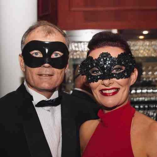 Couple in black lace masks