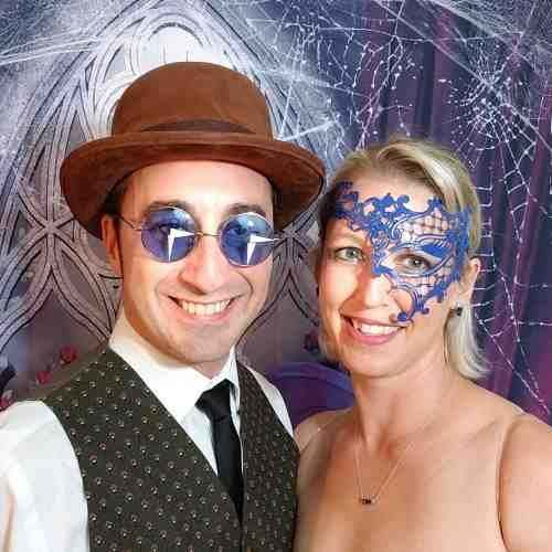Woman wearing half phantom with man in blue glasses