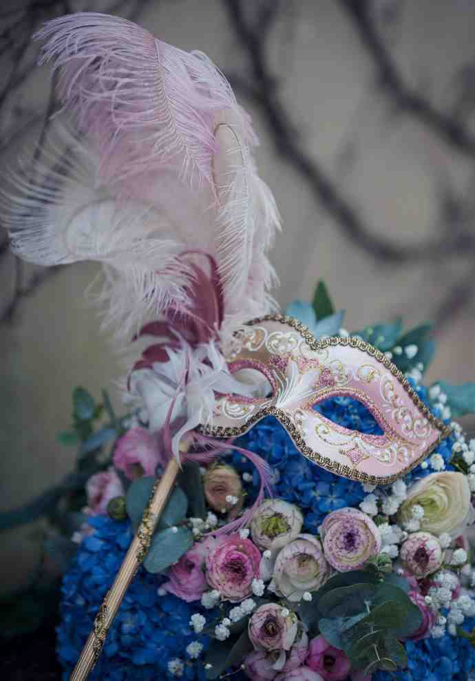Wedding mask used as brides bouquet