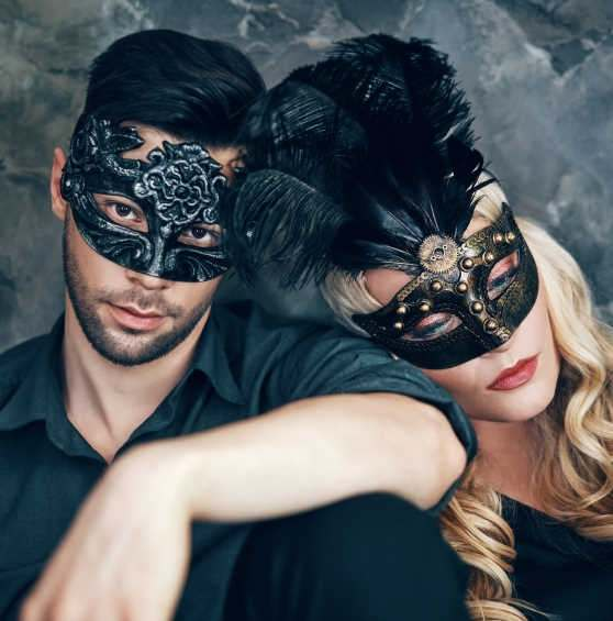 Couple wearing Venetian masks
