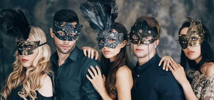 people wearing masks at masked ball